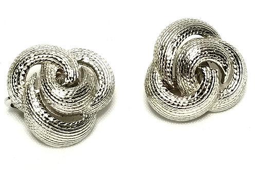 Designer by Crown Trifari, earrings, clip on, knot motif, silver tone.