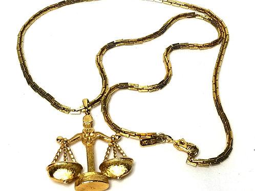 Designer by Monet, necklace, Libra Zodiac pendant in gold tone.