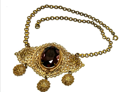 Designer by provenance, necklace, choker, purple oval stone, filigree setting.