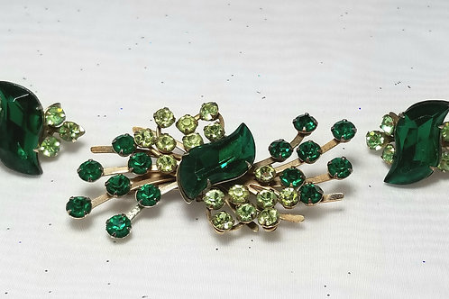 Designer by provenance,  brooch, green crystals in gold tone spray settings