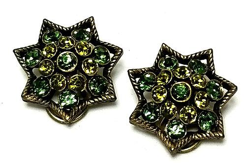 Designer by Kramer, earrings, clip on, star motif, green rhinestones, gold tone.