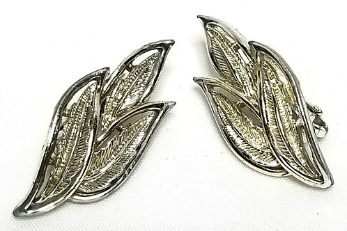 Designer by Coro, earrings, clip on, leaf motif, silver tone 5/8 x 1 1/2 inches.