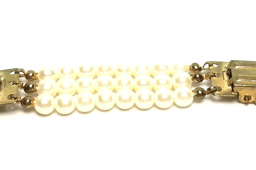 Designer by provenance, sweater catch, round white faux pearls, gold tone.