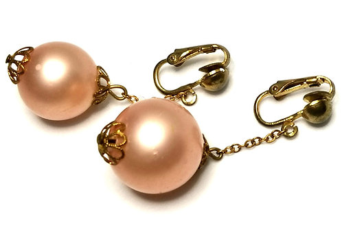 Designer by provenance, earrings, clip on drops, pink faux pearls, gold tone.
