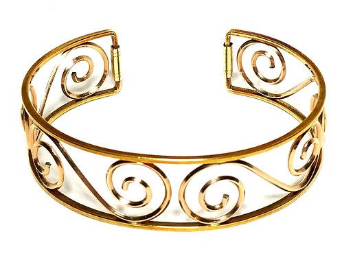 Designer by Krementz, bracelet, rose gold tone cuff, 7/8 inch wide.