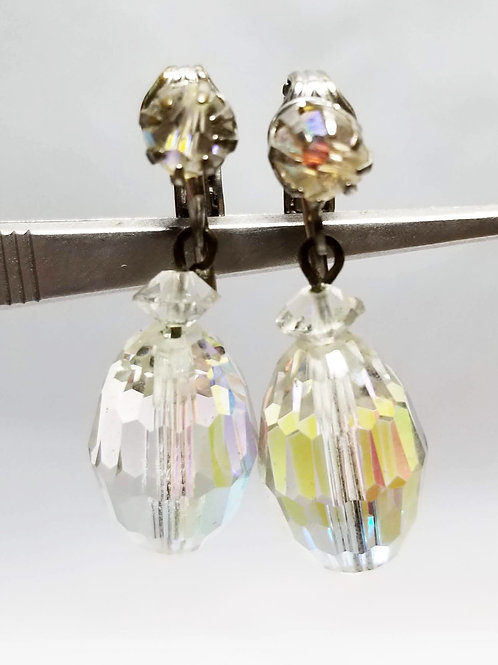 Designer by Laguna, earrings, clip on, dangles iridescent beads in silver tone.