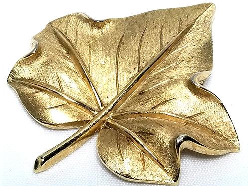 Designer by Crown Trifari, brooch, leaf motif, gold tone textured leaf.
