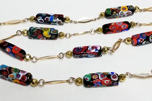 Designer by Millifiori, neck wear, multi-colored beaded in gold tone pot metal.