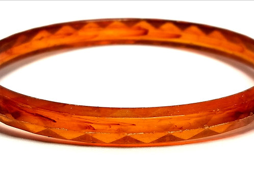 Designer by provenance, bracelet, bangle, amber/orange color material.