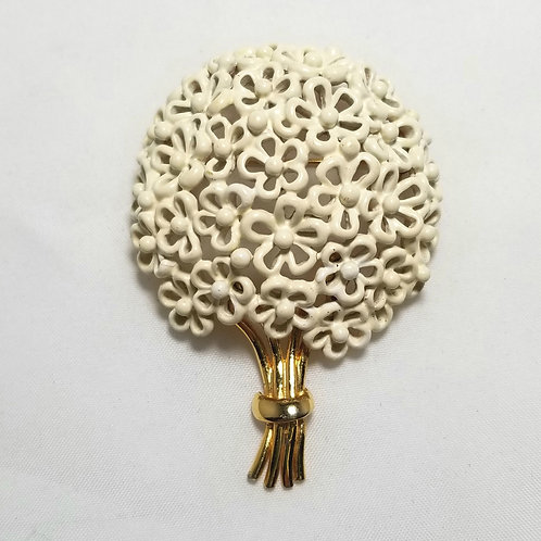 Monet brooch, floral bouquet in gold tone setting.