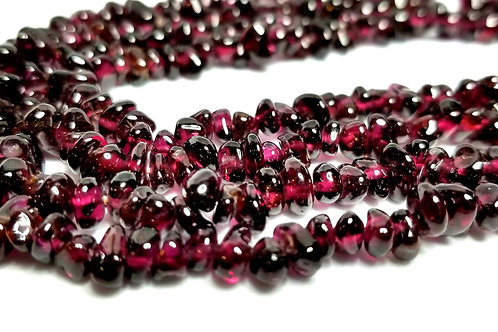 Designer by provenance, necklace, garnet beads, gold tone, 35 inches.