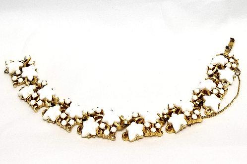Designer by Trifari, bracelet, stars motif, white stars in gold tone pot metal.