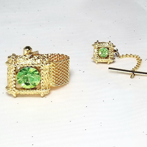 Designer by provenance, set, bold cuff links and tie tack, green and gold