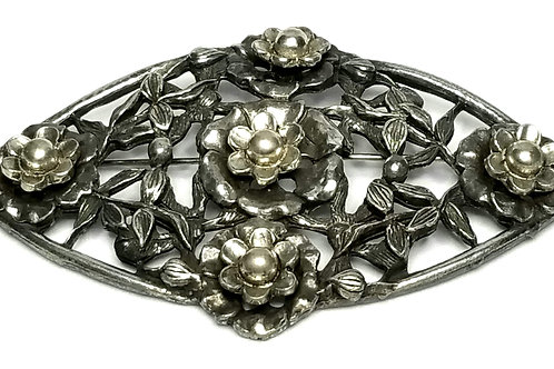 Designer by provenance, brooch, floral motif, silver tone, 3 1/4 inches.
