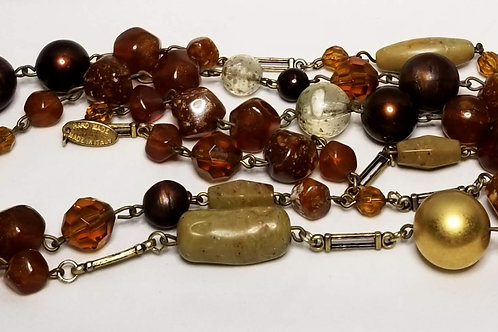 Designer by Express, necklace, brown and amber beads and gold tone, 50 inches