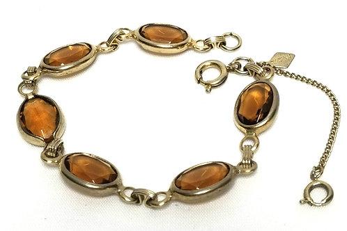 Designer by Sarah Cov, bracelet, brown topaz like faceted stones in gold tone.