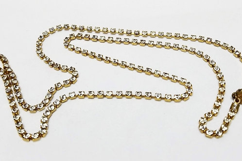 Designer by Miriam Haskell, neck wear, 30 inch rhinestone necklace in gold tone.