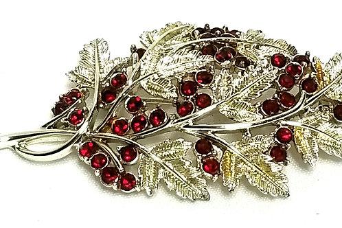 Designer by Coro, brooch, leaf motif, red round rhinestones in gold tone.