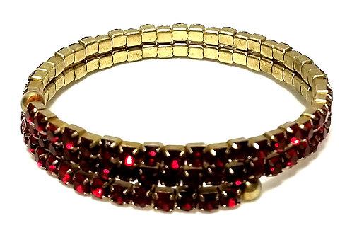 Designer by Liz Claiborne, bracelet, memory wire, red rhinestones in gold tone.
