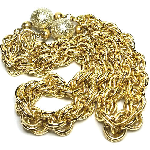 Designer by provenance, necklace, gold tone chains, gold tone glittered balls.