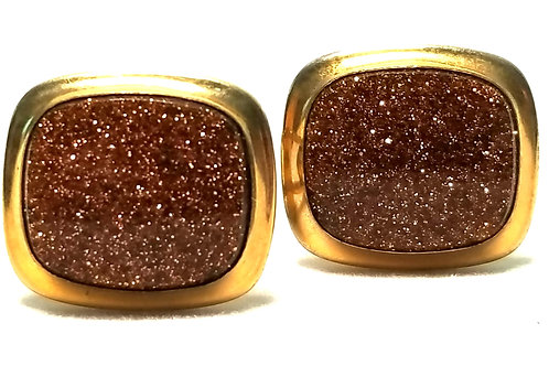 Designer by Correct, cuff links, copper color cabochons in gold tone.