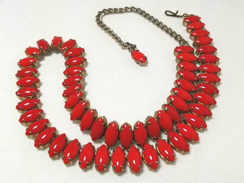 Designer by provenance.  Red and gold tone pot metal princess length necklace.