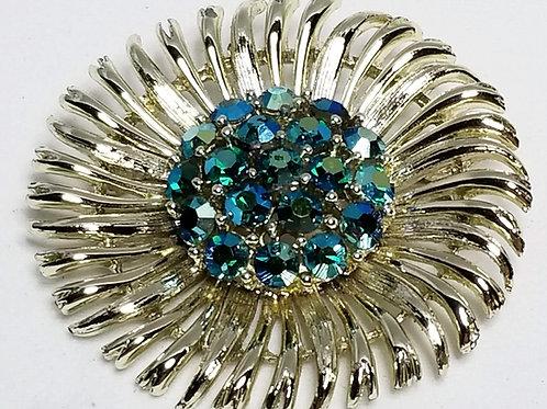 Designer by Lisner, brooch, flower motif, green rhinestones gold tone pot metal.