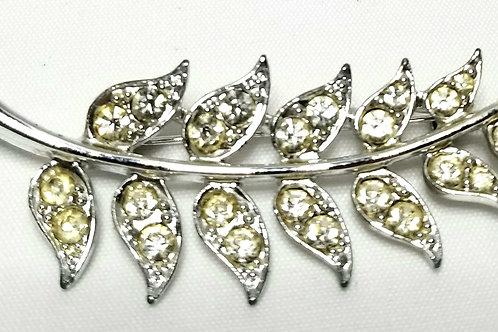 Designer By Sarah Cov, brooch, leaf motif, clear rhinestones in silver tone.