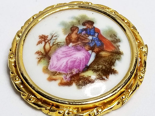 Designer by Limoges, brooch, painted porcelain in gold tone setting.