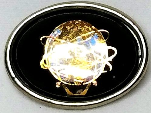 Designer by provenance, pin, globe motif, black Lucite, gold tone/silver tone.