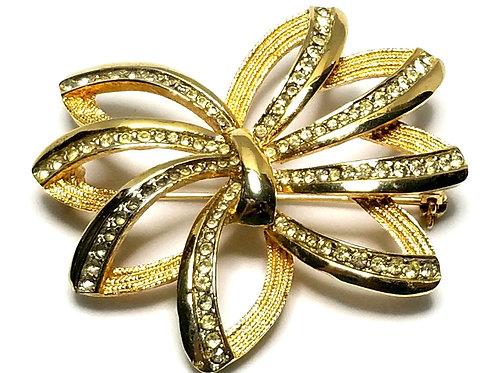 Designer by Kramer, brooch, flower motif, clear rhinestones, gold tone, 2 inches