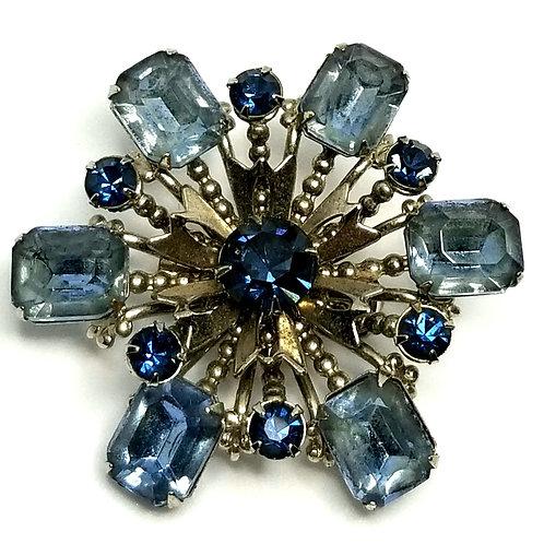Designer by provenance, brooch, blue faceted stones, blue rhinestones.