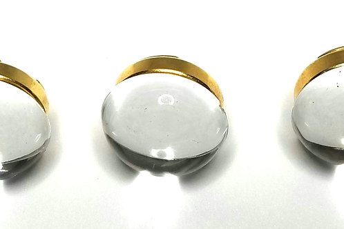 Designer by provenance, button covers, three, clear Lucite, gold tone.