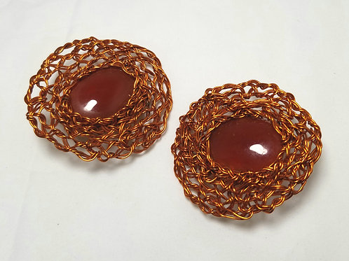 Earrings, red glass cabochons in copper color weaved metal.