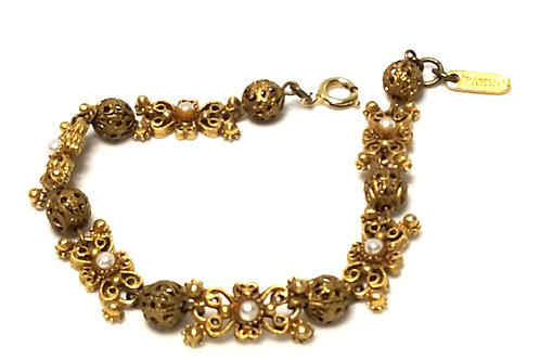 Designer by Florenza, bracelet, filigree with white seed pearls in gold tone.