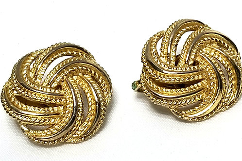 Designer by Trifari, earrings, clip on, knot motif in gold tone pot metal.