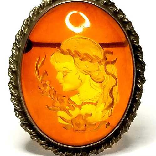 Designer by provenance, brooch/pendant, lady motif, amber color stone.