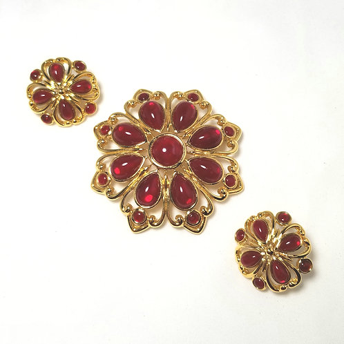 Trifari, set, brooch/earrings set, red glass stones in gold tone setting.