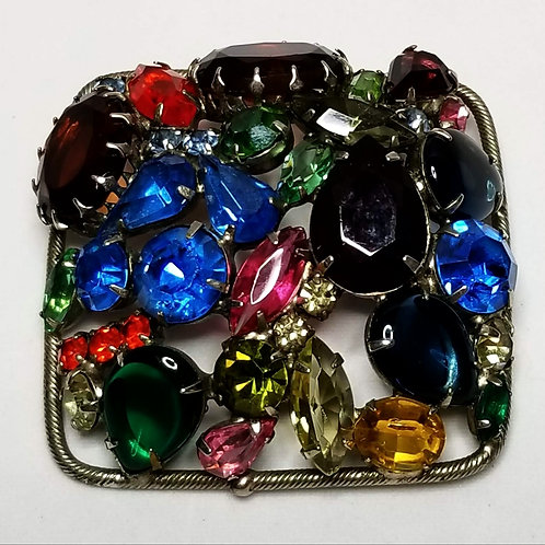 Designer by Juliana, brooch, multi colored stones in silver tone pot metal.