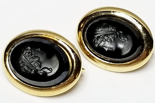Designer by Sarah Coventry, earrings, clip on black cameos in gold tone.