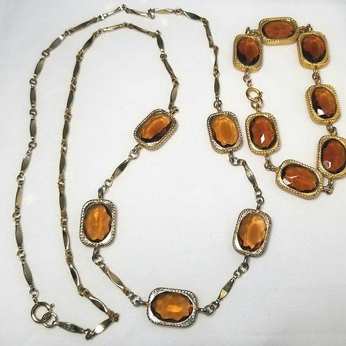 Designer by provenance, set, necklace and bracelet, brown oval faceted crystals