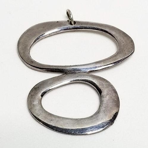 Designer by Norma Jean, pendant, silver tone circle theme.