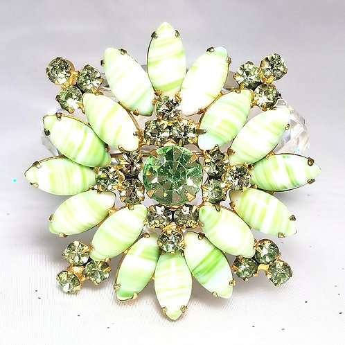 Designer by provenance, brooch, greens and white in gold tone setting