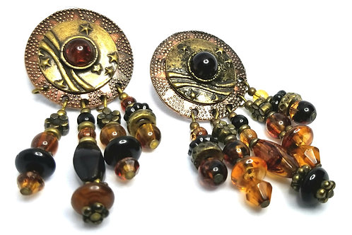 Designer by provenance, earrings, pierced dangles, brown and copper colors.