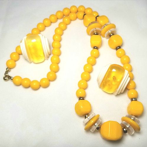 Designer by provenance, set, necklace and earrings, yellow beads and Lucite.