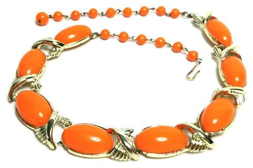 Designer by Coro, necklace, oval orange plastic stones and beads, gold tone.
