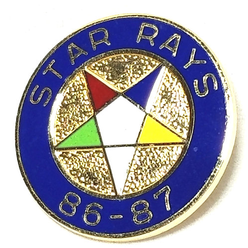 Designer by provenance, pin, Star Rays '86 '87 motif, multi color enamel.