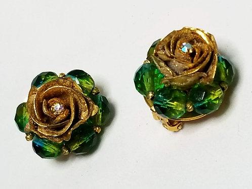 Designer by Carnegie, earrings, clip on green faceted beads, flower motif.