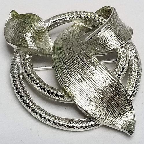 Designer by Lisner, brooch, ribbon motif in silver tone pot metal.