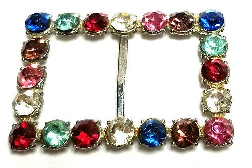 Designer by provenance, belt buckle, multi color faceted glass stones.